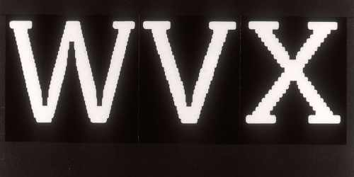 White characters on black read WVX, with jagged diagonal strokes